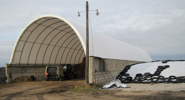 This former silo with fabric roof measures 40'x120' and serves as hay storage in winter and lambing space in spring.