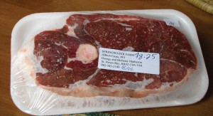 The lamb sold at the farmers' market is all fresh; anything that doesn't sell goes into the freezer. The label on this leg steak shows the name, address and phone number, as well as the date it was packaged and the total price. The weight is on the small label in the upper right corner.